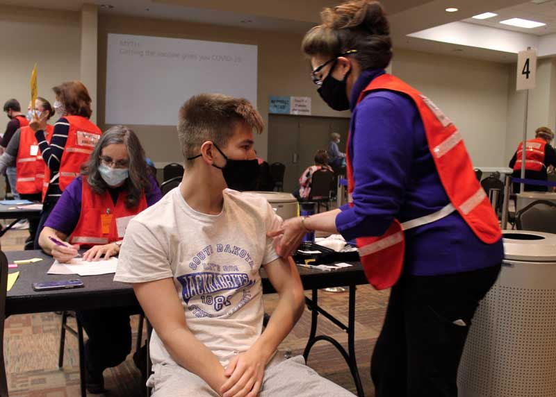 Carol Humburg, RN, finishes administering the COVID-19 vaccine to Marcus Harming at the April 22 walk-in community vaccination center. The Brookings County PPCC will hold another free, walk-in vaccination center this Thursday, April 29 from 8 a.m. to 4 p.m. at Swiftel Center. Single dose Janssen vaccines will be available to people age 18 and older.