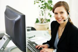 Woman with phone headset at a computer