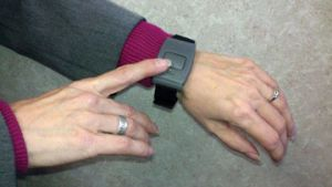 Personal activator button worn on the wrist