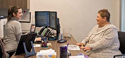 Patient financial counselor meeting with a patient