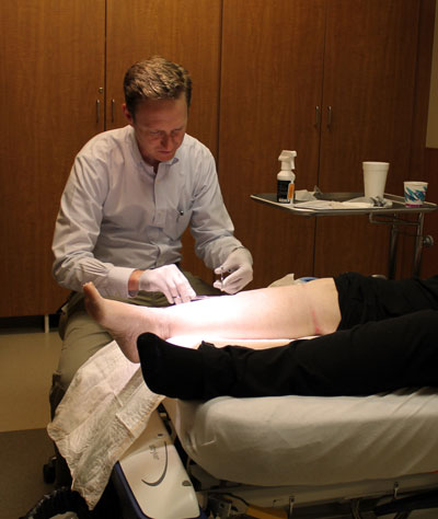 Dr. Jeffrey Johnson of Avera Medical Group performs debridement, the removal of dead and damaged skin from a patient's wound, at Brookings Hospital. Brookings Health System recently added debridement and amniografting to its existing same-day wound clinic services to enhance care options for wound patients.