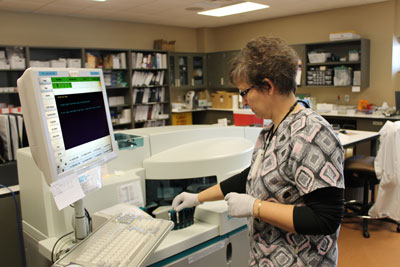Laboratory Technologist Sheila Schneider runs blood samples to test patient blood iron levels. Brookings Health System recently added four new blood tests to its laboratory to monitor iron levels in the blood as well as PSA.