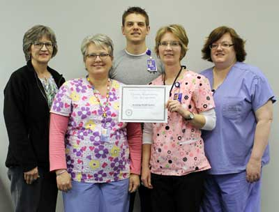 Members of Brookings Health System's respiratory care department stand with the certificate designating Brookings Health System as a quality respiratory care provider. From left: Judy Duffy, Janie Isham, Kelly Maser, Jean Steele, and Kara Drew.