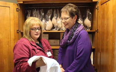 Mastectomy Fitter Renia Arneson shows a camisole to Angie Pickering, a breast cancer survivor from Arlington who uses the products and services available at the Brookings Health System/Avera Home Medical Store.