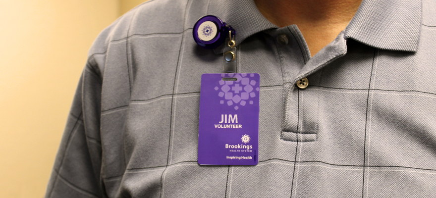 Close-up shot of volunteer wearing a name badge
